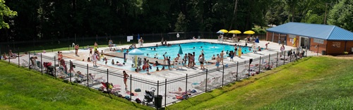 Adults and children enjoying the pool