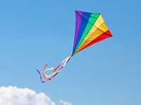 Rainbow colored kite flying