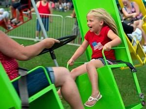 Fun on amusement ride at Fantastic Fourth 2013